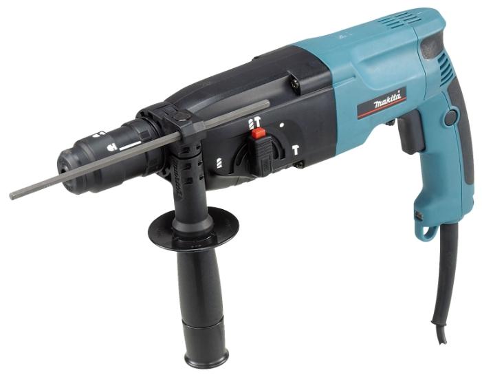 Перфоратор Makita HR2450FTПерфораторы<br><br><br>Тип крепления бура: SDS-Plus<br>Потребляемая мощность: 780 Вт<br>Макс. энергия удара: 2.7 Дж<br>Макс. диаметр сверления (дерево): 32 мм<br>Макс. диаметр сверления (металл): 13 мм<br>Макс. диаметр сверления (бетон): 24 мм<br>Питание: от сети<br>Шуруповерт: есть<br>Возможности: реверс, предохранительная муфта, электронная регулировка частоты вращения<br>Описание: лампа точечной подсветки