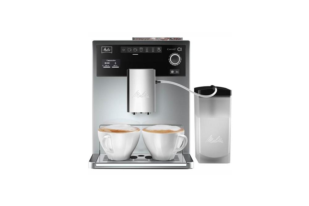 Кофемашина Melitta Caffeo CI Silver/BlackКофеварки и кофемашины<br>Melitta CaffeO СI - единственная в мире бытовая кофе-машина с возможностью программирования индивидуального рецепта кофейного напитка во время его приготовления.<br><br>В новой кофейной машине Melitta CaffeO СI с помощью уникальной программы «Мой кофе» можно однажды создать и сохранить 24 индивидуальных рецепта кофе, учитывая все нюансы предпочтений кофейного гурмана - от крепости напитка до температуры и объема молочной пенки. Чтобы получить любимый напиток достаточно нажать всего одну кнопку, а изменить рецептуру напитка можно даже в момент приготовления ...<br><br>Тип используемого кофе: Зерновой\Молотый<br>Мощность, Вт: 1400<br>Объем, л: 1.8<br>Давление помпы, бар  : 15<br>Материал корпуса  : Пластик<br>Встроенная кофемолка: Есть<br>Емкость контейнера для зерен, г  : 270<br>Одновременное приготовление двух чашек  : Есть<br>Подогрев чашек  : Есть<br>Контейнер для отходов  : Есть