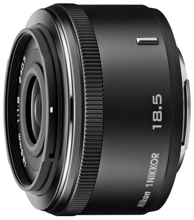 Объектив Nikon 1 NIKKOR 18,5mm/f1.8 Black (JVA102DA)Объективы<br>Чем порадует Nikon 1 NIKKOR 18,5mm/f1.8 Black (JVA102DA)?<br>Отличительная черта объектива Nikon 1 NIKKOR 18,5mm/f1.8 Black (JVA102DA) — высокая светосила. Вот почему изображения получаются такими четкими и резкими. Такой объектив просто незаменим для макросъемки, ведь минимальное расстояние фокусировки составляет 0,2 м!<br>Конечно, также радует и цена этого объектива. Как вы видите, его создатели позаботились не только о функциональности и стильном дизайне, но еще и о вашей выгоде. Бесспорно, приобретение такого объектива станет для вас очень выгодной покупкой, которая будет приносить...<br><br>Тип: Объектив<br>Фокусное расстояние: 18.5 мм<br>Диафрагма: F1.80<br>Минимальная диафрагма: F16<br>Крепление: Nikon 1<br>Число элементов / групп элементов: 8 / 6<br>Число лепестков диафрагмы: 7<br>Минимальное расстояние фокусировки: 0.2 м