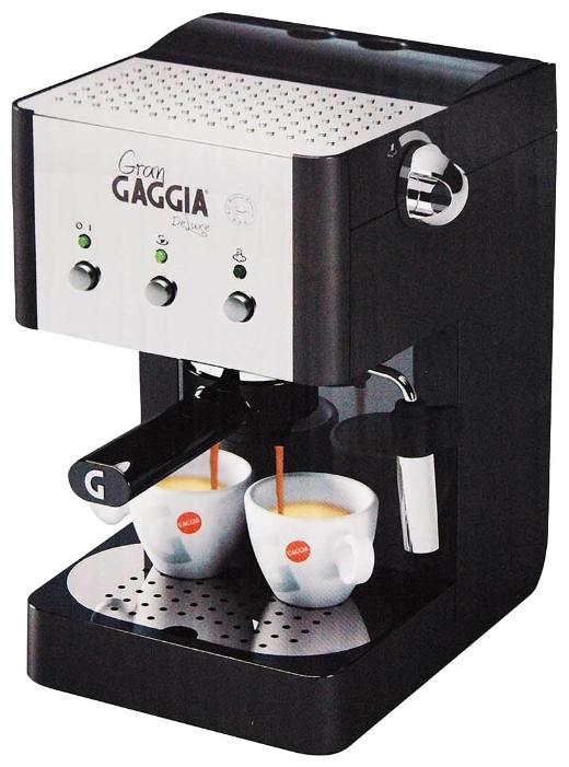 Кофемашина Gaggia Gran De Luxe BlackКофеварки и кофемашины<br>Новинка от итальянской компании Gaggia — маленькая компактная домашняя кофеварка GranGaggia de Luxe Black.<br><br>Рожок имеет удобную ручку и клапан «crema» для создания качественной стойкой кофейной пенки на эспрессо. Машина оснащена трубкой пара с насадкой «панарелло» для взбивания молока. Также трубка переключается в режим подачи горячей воды для приготовления горячих напитков или чая.<br><br>Специально выделенное место для мелкосетчатых фильтров и мерной ложки создаст идеальные условия хранения этих аксессуаров. На верхней панели — плита для хранения и подогрева...<br><br>Тип используемого кофе: Молотый\Чалды<br>Мощность, Вт: 1050<br>Объем, л: 1.25<br>Давление помпы, бар  : 15<br>Материал корпуса  : Пластик<br>Одновременное приготовление двух чашек  : Есть<br>Съемный лоток для сбора капель  : Есть